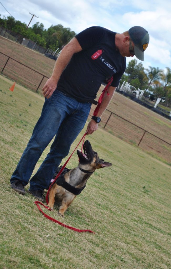 Author and Former Navy SEAL Eric Davis and his Malinois, India