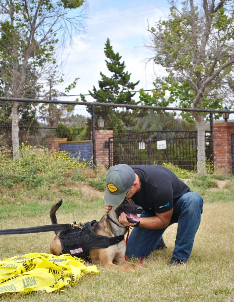 Author and former Navy SEAL Eric Davis with his Belgian Malinois, India